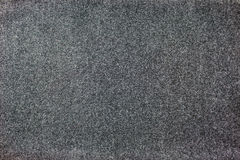Seamlessly grey carpeting background. Felted fabric dark color for the background texture Royalty Free Stock Photography