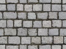 Seamlessly tiling cobbled road texture. Stock Photos