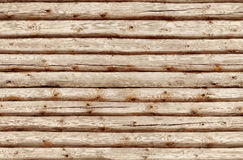 Seamlessly tiling wooden log wall. Royalty Free Stock Image