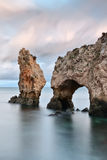 The seamounts with an arch. Portugal. Stock Photography