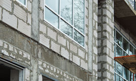Seams rough walls are covered with cement blocks. Detail of the facade of the building during the construction phase. Seams rough walls are covered with cement stock images