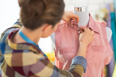 Seamstress adjusting clothing on mannequin Royalty Free Stock Photography
