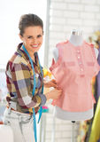 Seamstress adjusting clothing on mannequin Stock Photos