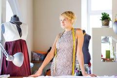 Seamstress in atelier studio Stock Photo