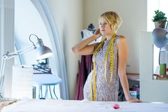 Seamstress in atelier studio Stock Photography