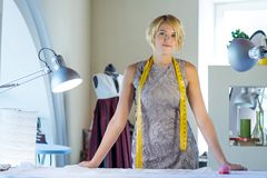 Seamstress in atelier studio Stock Image