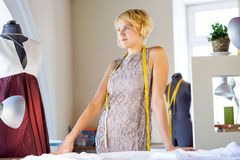 Seamstress in atelier studio Royalty Free Stock Image