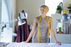 Seamstress in atelier studio Royalty Free Stock Photos