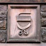 Old Seamstress Carving Over Cottage Door in Scotland royalty free stock photo