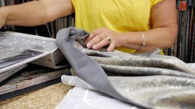 Seamstress or Designer Selects Fabric Samples for Sewing Curtains. Clothing and tailoring, sewing craftsmanship workplace concept stock video