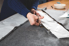 Seamstress hands cutting fabric Royalty Free Stock Photography