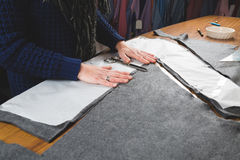 Seamstress hands cutting fabric Royalty Free Stock Photos
