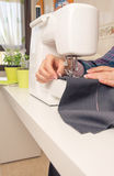 Seamstress hands working on a sewing machine Royalty Free Stock Images