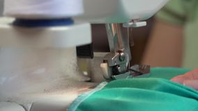 Seamstress makes clothes seams. On a sewing machine stock video footage