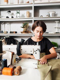 Seamstress making clothes. Workplace of  tailor Royalty Free Stock Images