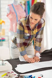 Seamstress making pattern on fabric Stock Photography