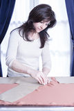 Seamstress marking a fabric Royalty Free Stock Images