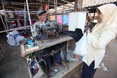 Seamstress. Old seamstress in the clothing market is finishing Boyolali village, Central Java, Indonesia Stock Image