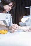 Seamstress pinning the fabric Stock Photos