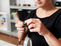 Seamstress put thread in needle. Stock Photo