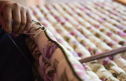 Seamstress's hand sewing the mattress Royalty Free Stock Photos