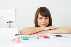 Seamstress and sewing machine Royalty Free Stock Photos