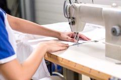 Seamstress sewing Stock Photo