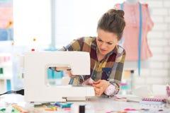 Seamstress sewing in studio Stock Image