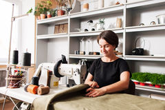 Seamstress sews clothes. Workplace of tailor Stock Image