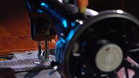 Seamstress sews on a sewing machine stock footage