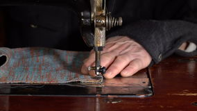 Seamstress sews on a sewing machine. Slow motion stock video footage