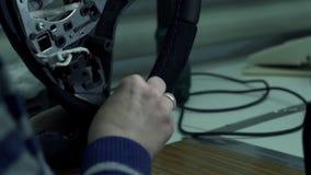 Seamstress sheathes car wheel arms stock video footage