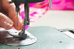 Seamstress threading sewing machine Stock Images