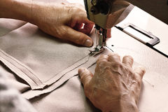 Seamstress using Sewing Machine hands focus Royalty Free Stock Photo