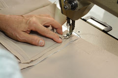 Seamstress using Sewing Machine hands focus Stock Photos