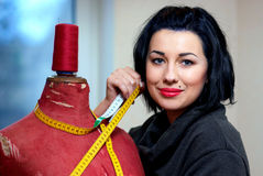 Seamstress With Red Old Mannequin Stock Photography