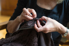 Seamstress. Woman hands sewing a dress Stock Photo