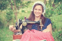 Seamstress woman with vintage sewing machine Stock Images