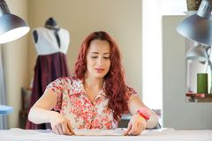 Seamstress woman at work Royalty Free Stock Image