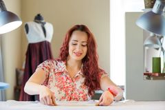 Seamstress woman at work Royalty Free Stock Photos