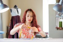 Seamstress woman at work Stock Photos