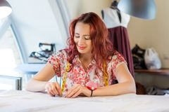 Seamstress woman at work Stock Photography