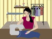 Seamstress. Women woman sews the dress Stock Photos