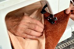 A seamstress at work in her home royalty free stock image