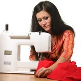 Seamstress work on the sewing-machine Royalty Free Stock Images