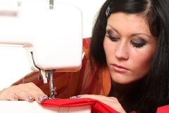 Seamstress work on the sewing-machine Stock Image