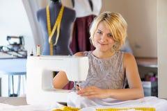 Seamstress at work Stock Images