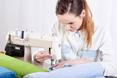 Seamstress at work Stock Images