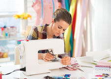 Seamstress working with sewing machine Royalty Free Stock Photos