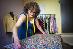 Seamstress working for the tailoring royalty free stock photos